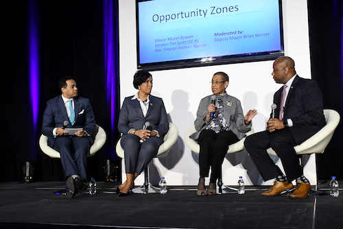 D.C. Deputy Mayor for Planning and Economic Development Brian Kenner moderates a panel with Mayor Muriel Bowser, Del. Eleanor Holmes Norton and Sen. Tim Scott (R-S.C.) at the Entertainment & Sports Arena in Congress Heights. (Roy Lewis/The Washington Informer)