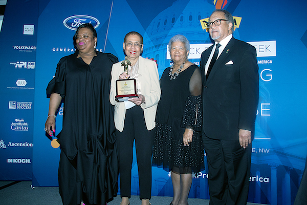 Del. Eleanor Holmes Norton (second from left), recipient of the Torch Award for Outstanding Leadership and Achievement in Support of the Black Press of America, poses with the award at a March 21 event during Black Press Week while alongside Amelia Ashley-Ward (left), NNPA Chair Dorothy Leavell (second from right) and Benjamin Chavis, NNPA president and CEO. (Shevry Lassiter/The Washington Informer)
