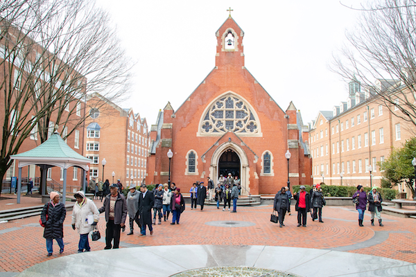 The Washington Informer African American Heritage Tour on the campus of Georgetown University at Dahlgren Chapel of the Sacred Heart, which was built in 1893 (Shevry Lassiter/The Washington Informer)