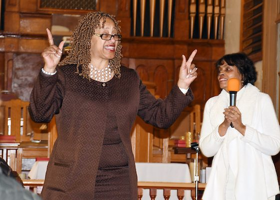 The pastor of Mt. Zion United Methodist Church, Johnsie W. Cogman (left), welcomes the Washington Informer Charities African American Heritage Tour to her church. (Roy Lewis/The Washington Informer)