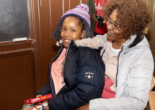 A grandmother enjoys spending time with her granddaughter on the Washington Informer Charities African American Heritage Tour of Black Georgetown on March 2. (Shevry Lassiter/The Washington Informer)