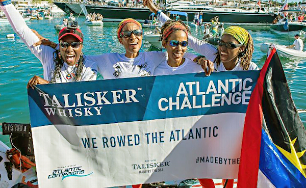 The Island Girls rowed more than 3,000 miles across the Atlantic Ocean over 47 days, eight hours and 25 minutes for the Talisker Whisky Atlantic Challenge. Upon reaching their final destination, they celebrated. (Gemma Hazlewood)