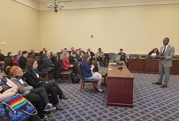 Maryland Del. Jazz Lewis (right) speaks with criminal justice advocates on March 12 before he and Del. Wanika Fisher present their sponsored legislation to limit and ban the use of solitary confinement in state jails and prisons. (William J. Ford/The Washington Informer)