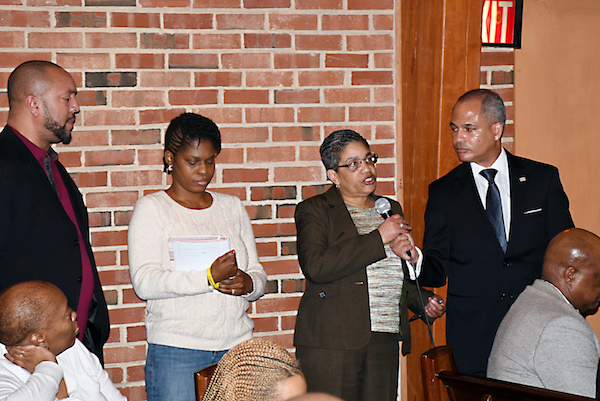 Deborah Evans-Bailey, mother of murder victim Kendra Smith, asks about the long list of outstanding murders in the District of Columbia, and when will some of them be solved during a community forum in northeast D.C. on March 11. (Roy Lewis/The Washington Informer)