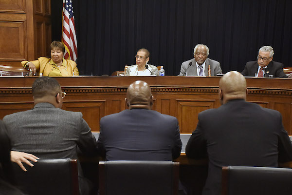 D.C. Del. Eleanor Holmes Norton (second from left) and Rep. Danny K. Davis (second from right), co-chairs of the Congressional Caucus on Black Men and Boys, hold a caucus hearing with Rep. Eddie Bernice Johnson (left) and Rep. Bobby Scott (right) on mentoring programs for Black men and boys on March 12. (Robert R. Roberts/The Washington Informer)