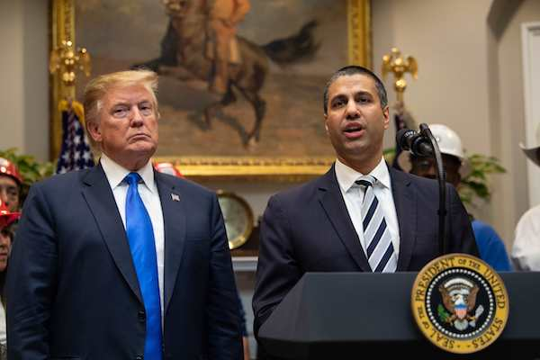 **FILE** President Donald Trump listens to Federal Communications Commission (FCC) chairman Ajit Pai speak during an announcement about 5G network deployment in the Roosevelt Room at the White House in D.C. on April 12, 2019. (Nicholas Kamm/AFP/Getty Images)