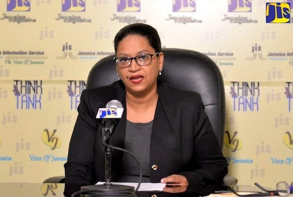 Nicola Russell, manager of the the Development Bank of Jamaica's Public-Private Partnership and Privatisation division, speaks at a JIS think tank event. (Courtesy of JIS)