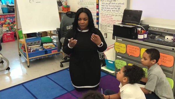 Kelly Harper instructs students at Amidon-Bowen Elementary School. (Screen shot courtesy of ABC News)