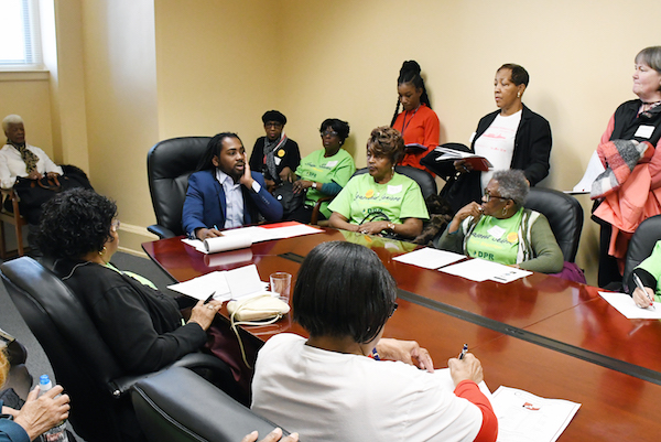 D.C. Council member Trayon White (D-Ward 8) listens to a Ward 8 senior resident during the 2019 Senior Advisory Day at the John A. Wilson Building in northwest D.C. on April 1. (Roy Lewis/The Washington Informer)