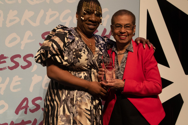 D.C. Del. Eleanor Holmes Norton and #MeToo movement founder Tarana J. Burke embrace at the fourth annual First Expressions Awards at the Newseum in D.C. on April 4. (Shevry Lassiter/The Washington Informer)