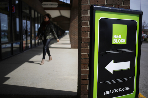 **FILE** Signage is displayed outside an H&R Block Inc. location in Louisville, Kentucky, on March 23, 2017. H&R Block is one of the largest tax return preparers in the U.S., where it boasts more than 12,000 company-owned and franchised retail locations. (Luke Sharrett/Bloomberg via Getty Images)