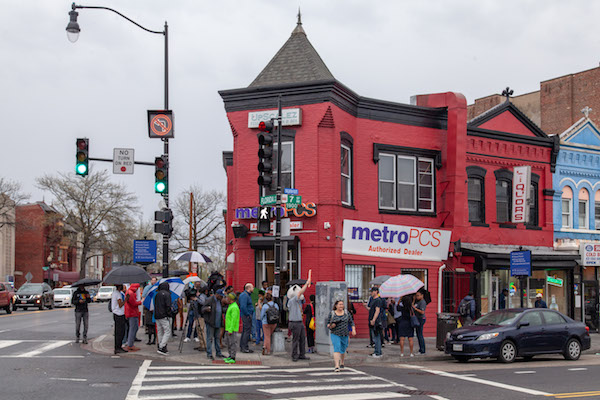 A crowd gathers at MetroPCS on 7th and U streets in northwest D.C. during a protest of a threat from the company's corporate office to shutter the store if the music doesn't stop. (Ja'Mon Jackson/WI Bridge)