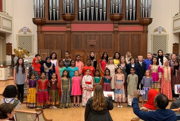 "The 2019 Interfaith Youth Choir performs during ""Dr. King's Vision: Humanity Tied in a Single Garment of Destiny,"" an event hosted by the InterFaith Council of Metropolitan Washington and the Council of Churches of Greater Washington, at the New York Avenue Presbyterian Church in D.C. on April 7. (Hamil R. Harris/The Washington Informer)"