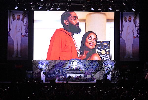 Photos are displayed during Nipsey Hussle's Celebration of Life at Staples Center on April 11, 2019 in Los Angeles, California. Nipsey Hussle was shot and killed in front of his store, The Marathon Clothing, on March 31, 2019 in Los Angeles. (Photo by Kevork Djansezian/Getty Images For Atlantic Records)