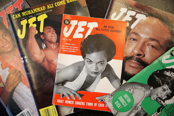 **FILE** Vintage copies of Jet magazine are displayed in the offices of Johnson Publishing Company on June 9, 2014, in Chicago. The final print edition of the magazine hits newsstands this month. First published in 1951 and billed as 'The Weekly Negro News Magazine', Jet recently has been published every three weeks with a circulation of 700,000. Johnson Publishing will continue to publish a weekly online edition of Jet. (Photo Illustration by Scott Olson/Getty Images)