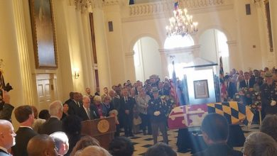 Photo of Busch Lies in Repose at State House as Mourners Pay Tribute