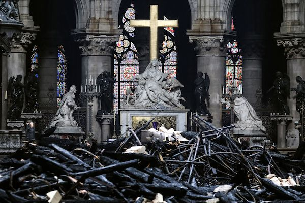 A picture taken on April 16, 2019, shows the altar surrounded by charred debris inside the Notre-Dame Cathedral in Paris in the aftermath of a fire that devastated the cathedral. French investigators probing the devastating blaze at Notre-Dame Cathedral on April 15, 2019, questioned workers who were renovating the monument on April 16, as hundreds of millions of euros were pledged to restore the historic masterpiece. As firefighters put out the last smouldering embers, a host of French billionaires and companies stepped forward with offers of cash worth around 600 million euros ($680 million) to remake the iconic structure. (Ludovic Marin/AFP/Getty Images)