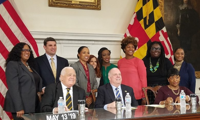 **FILE** Maryland Gov. Larry Hogan (center) poses for a photo at the last bill signing event of 2019 alongside House Speaker Adrienne Jones (right, seated) and Senate President Thomas V. Mike Miller Jr. in Annapolis on May 13. (William J. Ford/The Washington Informer)