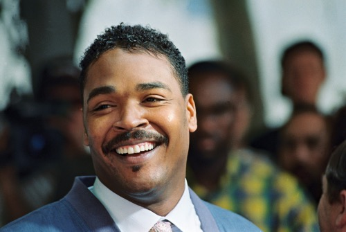 **FILE** Rodney King, the Los Angeles motorist whose beating by police was captured on videotape, smiles, 01 May 1992 in Beverly Hills, during a press conference, where he called for the end of violence in the city. The 1992 Los Angeles riots, with looting and arson events, erupted 29 April 1992 when a mostly white jury acquitted the four police officers accused in the videotaped beating of black motorist Rodney King, after he fled from police. 52 people were killed during the riots and Rodney King became a reluctant symbol of police brutality. (Robert Sullivan/AFP/Getty Images)