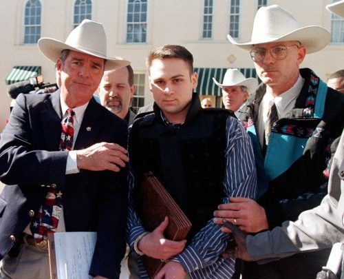 "**FILE** John William ""Bill"" King (center) is led from the Jasper County Courthouse by unidentified deputies following the first day of jury selection in his murder trial in Jasper, Texas, on Jan. 25, 1999. King and two other men are accused of the death of James Byrd Jr., a 49-year-old disabled black man. (Paul Buck/AFP/Getty Images)"