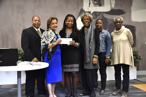 The Washington Informer Charities President Denise Rolark Barnes (3rd from left) receives a grant from Humanities DC — formerly known as the Humanities Council of Washington, DC — at Uline Arena in northeast D.C. on May 15. (Robert Roberts/The Washington Informer)