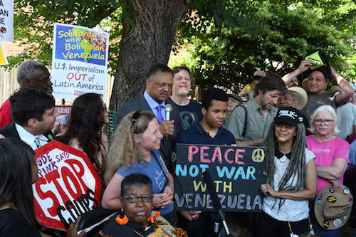The Rev. Jesse Jackson (center) shows support for the pro-Maduro quartet in a march from the Venezuelan Embassy to the White House and led chants during a protest at the Venezuelan Embassy in northwest D.C. on May 19. (Roy Lewis/The Washington Informer)