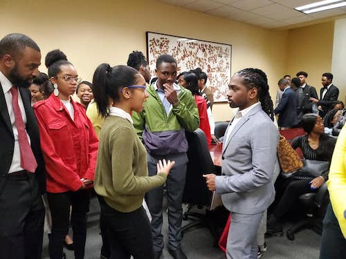 Banneker Academic High School student advocates meet with Ward 8 Council member Trayon White (right) on May 14 to garner his support for a newly built state-of-the-art education campus. (Courtesy of Wendy Glenn via Facebook)