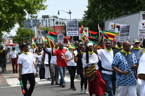 Protesters march May 25 from the African American Civil War Memorial on U Street in northwest D.C. to the White House, opposing U.S. economic sanctions against Zimbabwe. (Roy Lewis/The Washington Informer)