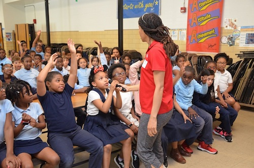 Dezirae Pena, 8, responds to a question about water safety from Janique Muckelvene, who works for the Maryland-National Capitol Park and Planning Commission on May 23. The agency visited schools such as Capitol Heights to celebrate May as National Water Safety Month. (Anthony Tilghman/The Washington Informer)