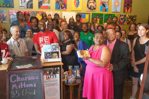 Family and friends gather at Busboys and Poets in southeast D.C. on May 29 to honor the life of journalist Charnice Milton, who was slain in 2015. (Shevry Lassiter/The Washington Informer)