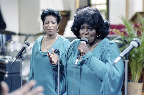 """Billie Barrett Greenbey (left) and Delois Barrett Campbell, two of the Barrett Sisters, perform in a scene from the documentary """"Say Amen, Somebody."""" (Smithsonian National Museum of African American History and Culture)"""