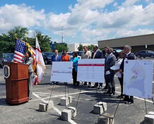 Prince George's County Executive Angela Alsobrooks speaks during a May 31 press conference at The Landing at Woodyard shopping center in Clinton to announce that nine county shopping centers will receive $1.9 million for façade improvements and other upgrades. (William J. Ford/The Washington Informer)