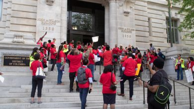 Teachers and supporters rally at Freedom Plaza and on the steps of the Wilson Building in northwest D.C. on April 25 to protest funding cuts to the budget for D.C. Public Schools, most of which are in Southeast. (Shevry Lassiter/The Washington Informer)
