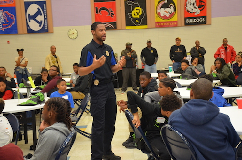 Cpl. Trevin Shepard instructs young men on how to interact with the police during an overnight program at Oakcrest Community Center in Capitol Heights on April 26, hosted by the Maryland-National Capital Park and Planning Commission. (Anthony Tilghman/The Washington Informer)