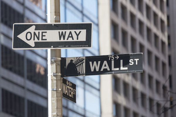**FILE** New York city navigation: Wall street signboard with Water street and one way signboards fixed on a pole at a traffic intersection in New York city, USA. (Roberto Machado Noa/LightRocket via Getty Images)