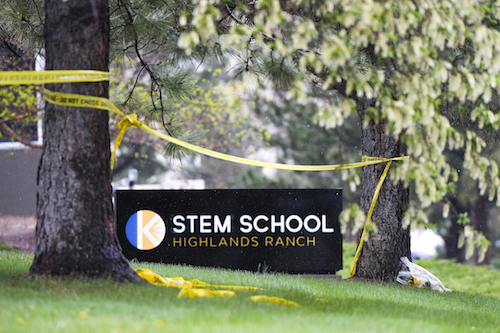 A small vigil sits next to the entrance to the STEM School Highlands Ranch in Highlands Ranch, Colorado, on on May 8, 2019, one day after two students entered the school with pistols, killing one student and injuring eight others. (Michael Ciaglo/Getty Images)