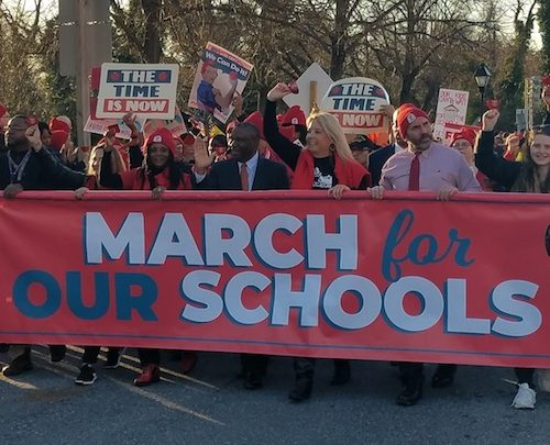 **FILE** Prince George's County school board Chairman Alvin Thornton (center in black suit) helps hold a banner during the March for Our Schools rally in Annapolis on March 11, 2019. (William J. Ford/The Washington Informer)