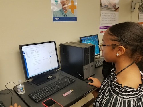 Trinity Jones, a senior at Gwynn Park High School in Brandywine, Md., reviews coding work the class conducted this year as part of Amazon Future Engineer program. (William J. Ford/The Washington Informer)
