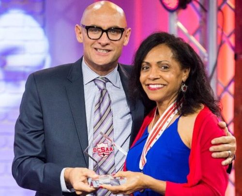 Esther Stroy-Harper is honored by DC Sports Athletic Association  Executive Director Clark Ray during the DCSAA's third annual High School Hall of Fame ceremony at the city's Office of Cable Television, Film, Music and Entertainment in northeast D.C. on June 6.