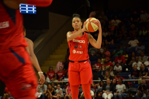 Washington Mystics guard Natasha Cloud scans the floor during a 96-75 victory over the Atlanta Dream on June 1, the Mystics' inaugural game at their new home venue, the Entertainment and Sports Arena in southeast D.C. (Anthony Tilghman/The Washington Informer)