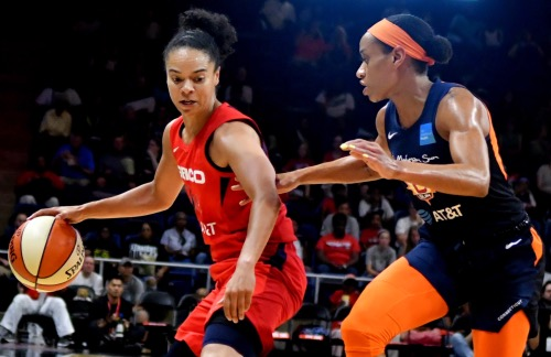 Washington Mystics guard Kristi Toliver is defended by Connecticut Sun guard Jasmine Thomas during the Mystics' 102-59 win at Entertainment and Sports Arena in southeast D.C. on June 29. (John E. De Freitas/The Washington Informer)
