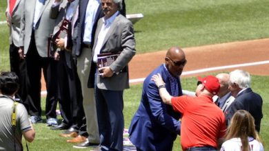 Washington Redskins great Charles Mann, one of the 10 newest members of the D.C. Sports Hall of Fame, is greeted during a induction ceremony prior to Washington Nationals' game against the Atlanta Braves at Nationals Park in D.C. on Sunday, June 23. (John E. De Freitas/The Washington Informer)