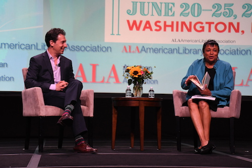 """Librarian of Congress Carla Hayden talks with author Eric Klinenberg, about his latest book """"Palaces For the People: How Social Infrastructure Can Help Fight Inequality, Polarization, and the Decline of Civic Life,"""" at the 2019 American Librarian Association's annual conference in northwest D.C. on June 22. (Roy Lewis/The Washington Informer)"""