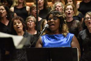 Soloist Rhea Walker leads the choir. (Robert Roberts/The Washington Informer)