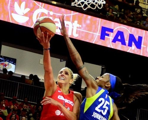 Washington Mystics forward Elena Delle Donne attempts a layup against Dallas Wings forward Glory Johnson during the Mystics' 86-62 win at Entertainment and Sports Arena in southeast D.C. on June 9. (John De Freitas/The Washington Informer)