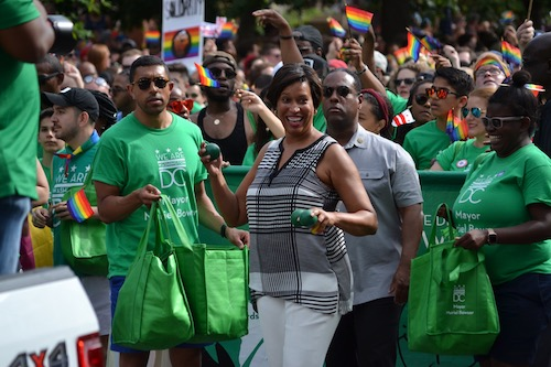 D.C. Mayor Muriel Bowser and supporters participate in the annual Capital Pride Parade at Dupont Circle in Northwest on June 8 before festivities were brought to a halt with reports of gunfire that turned out to be a BB gun. (Brigette Squire/The Washington Informer)