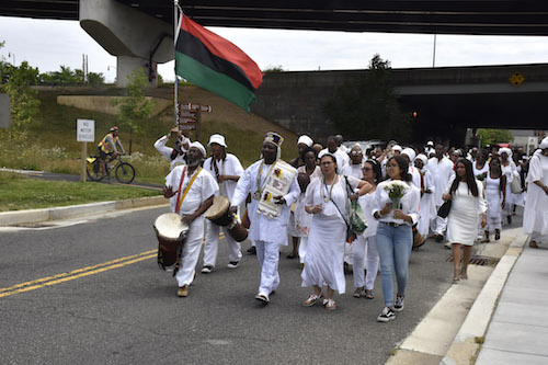 A procession from Union Temple Baptist Church heads to the Anacostia River for a spiritual healing ceremony on June 8 during the African Diaspora Ancestral Commemoration Institute's 27th annual commemoration in honor of the millions of Africans who perished during the Middle Passage. (Robert R. Roberts/The Washington Informer)