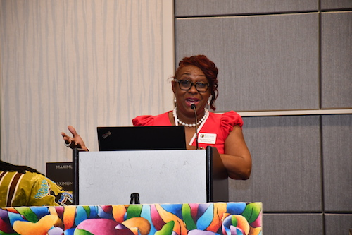 "Jan Desper Peters, executive director of the Black Mental Health Alliance, speaks at the ""Can We Talk?"" conference and benefit dinner, held at the Grand Hyatt Washington in Northwest Washington over the weekend."