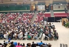 Benjamin Sinclari (onstage) gives advice to participants of the Prince George's County Summer Youth Enrichment Program during a kickoff event for the annual program at the Show Place Arena in Upper Marlboro on June 17. (William J. Ford/The Washington Informer)