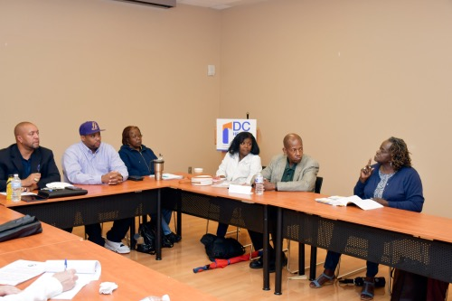 Health advocates, hospital workers and residents discuss the health care needs of East of the River and the impending closure of United Medical Center during an event sponsored by the DC Health Justice Coalition in Southeast on July 11. (Anthony Tilghman/The Washington Informer)